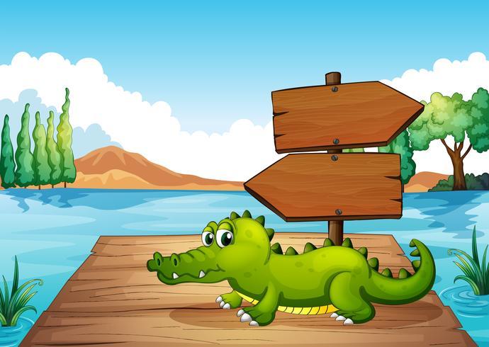 Un coccodrillo vicino allo stagno