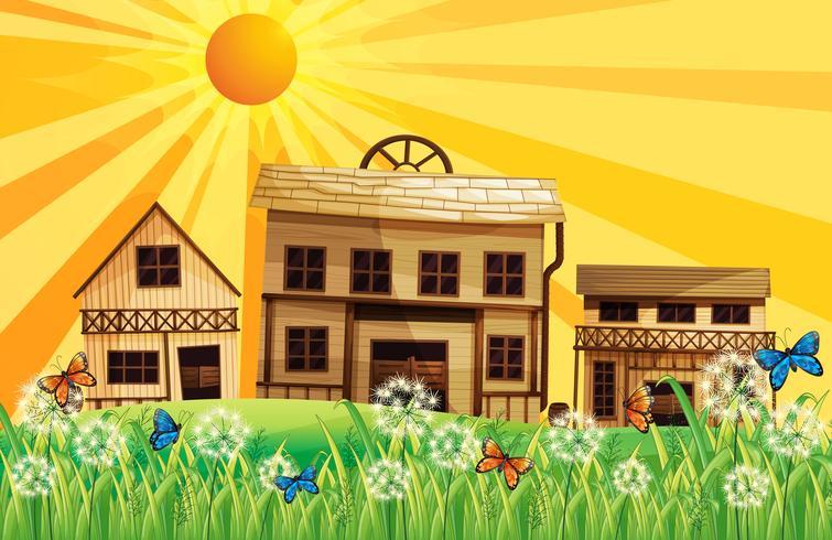 De houten huizen en de zonsondergang