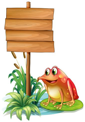 A frog above a waterlily beside a wooden signboard