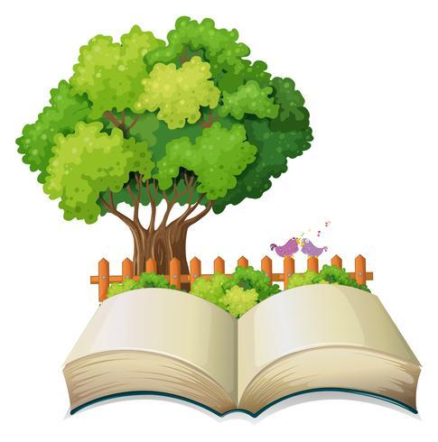 En tom öppen bok och ett träd med ett staket
