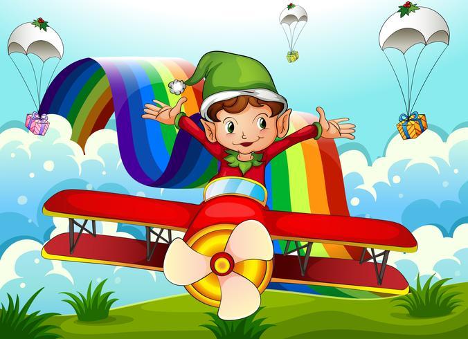 Un avión con un elfo y un arco iris en el cielo con paracaídas.