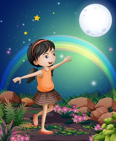 Ein glückliches junges Mädchen, das nahe den Blumen spielt