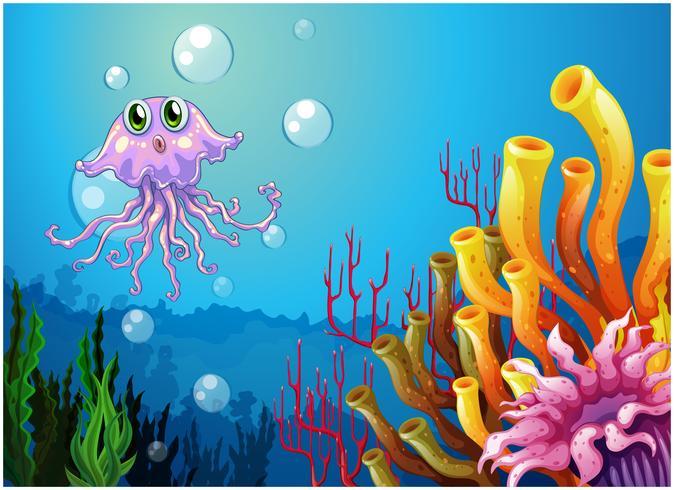 Un pulpo y los arrecifes de coral bajo el mar.