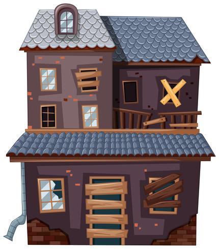 Casa de ladrillo con puerta rota y ventanas.