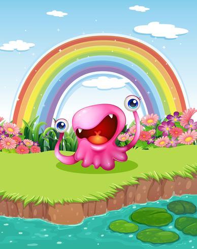 Un mostro allo stagno con un arcobaleno nel cielo
