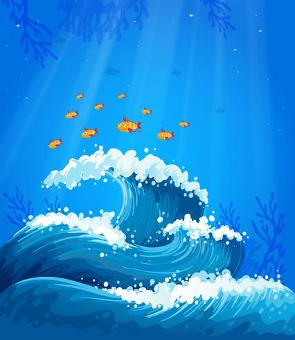 Una ola y peces bajo el mar.