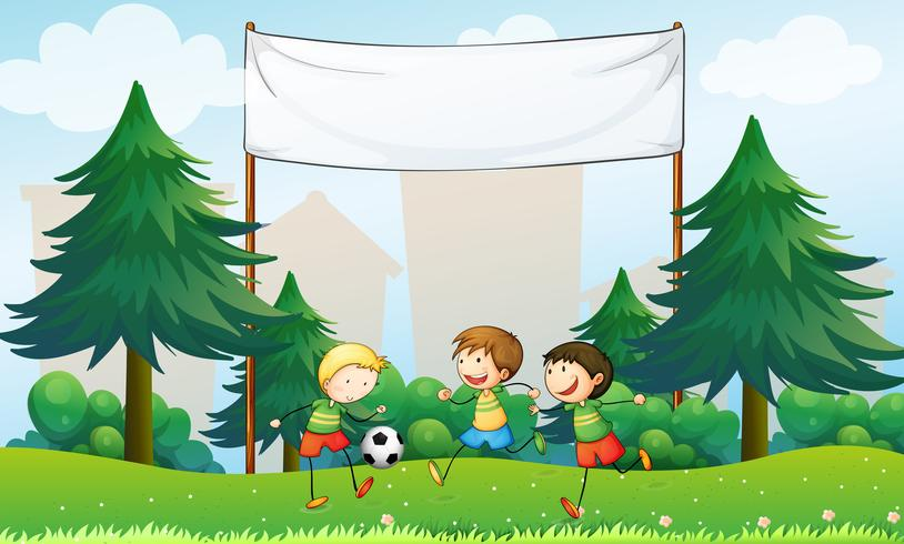 Three boys playing soccer below an empty banner vector