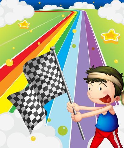 Un ragazzo in possesso di una bandiera da corsa nel campo di gara
