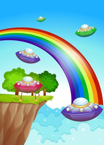 Dischi volanti nel cielo vicino all'arcobaleno