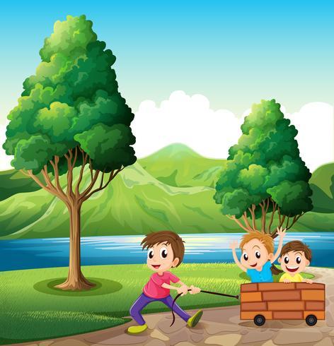 Boys playing at the riverbank vector