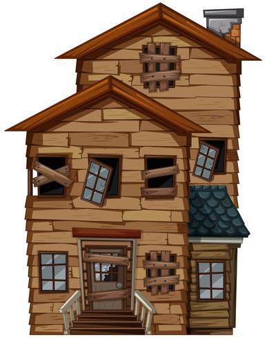 Antigua casa con ventanas rotas.