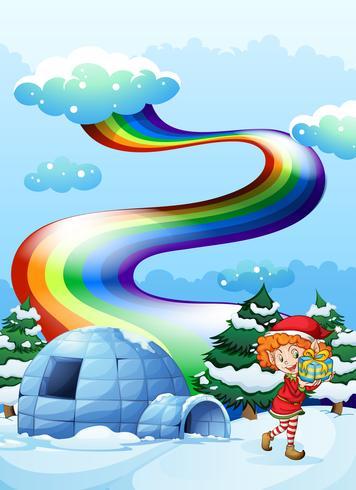 Un elfo cerca del iglú con un arco iris en el cielo.