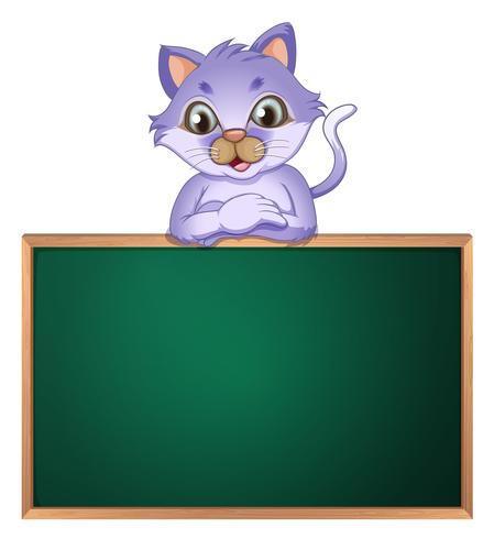 A cat leaning above the empty blackboard