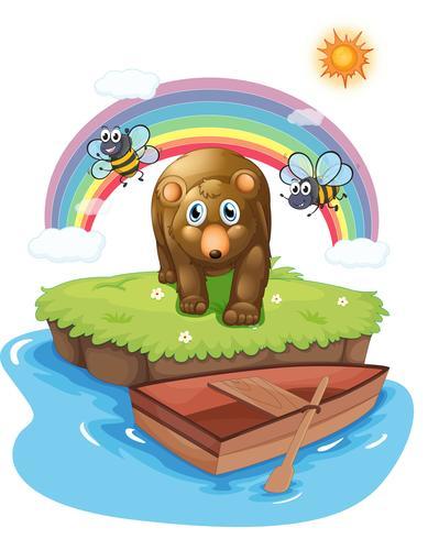Un orso bruno e la barca di legno