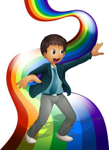 Een jongen die boven de regenboog danst vector