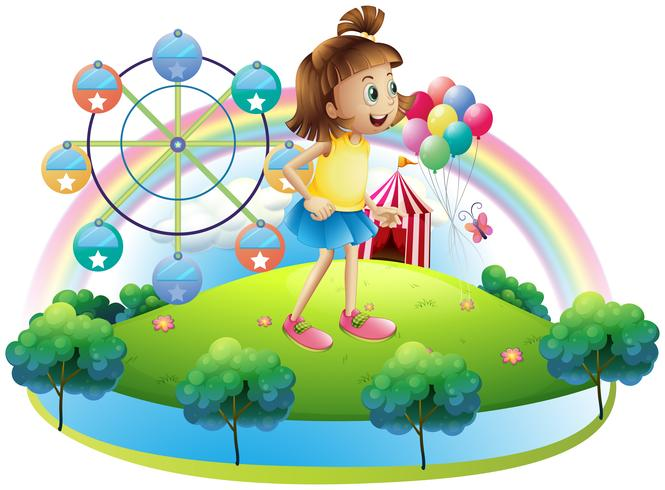 Een jong meisje in het pretpark