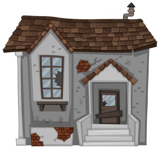 Tegelhus med trasig dörr och fönster