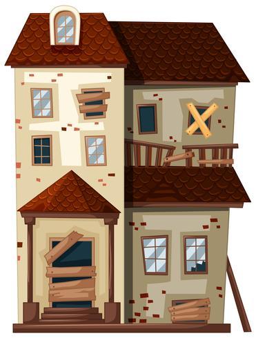 Oud huis met gebroken ramen en deuren