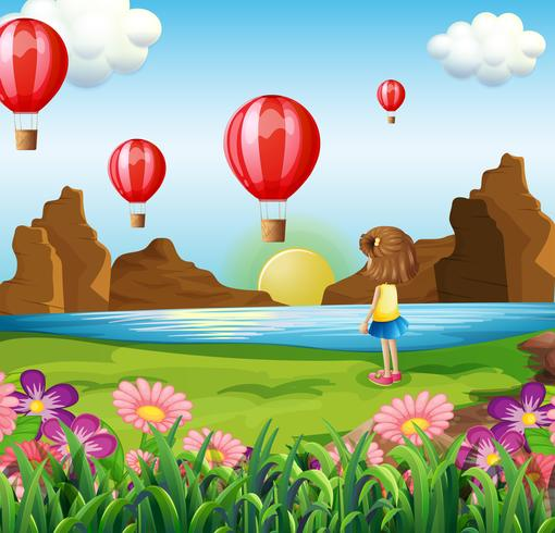 Una ragazza che guarda i palloni galleggianti