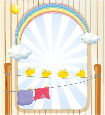 Quatre oiseaux jaunes et deux vêtements suspendus sous le soleil