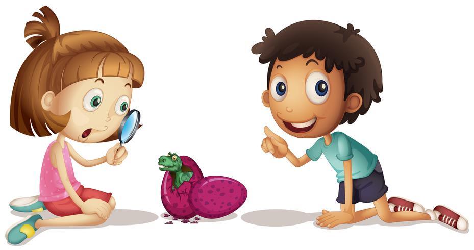 Bambini che guardano le uova da cova di dinosauro