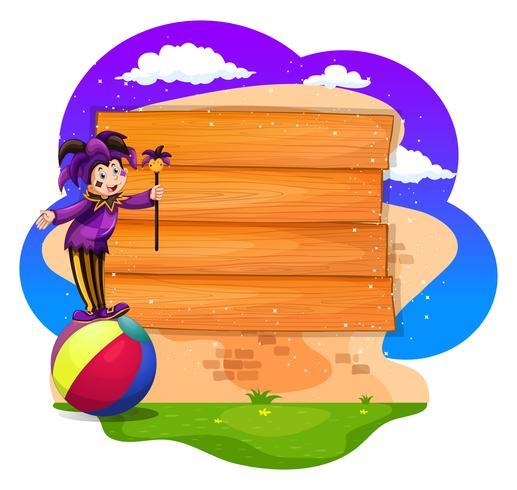 Tavola di legno con pagliaccio sulla palla
