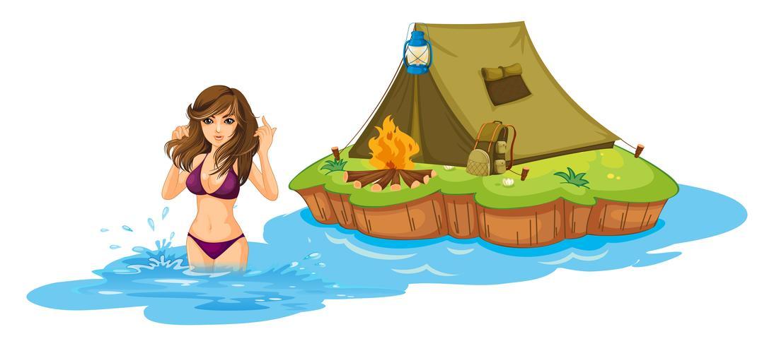 Ein sexy Mädchen, das nahe der Insel mit einem Campingzelt schwimmt
