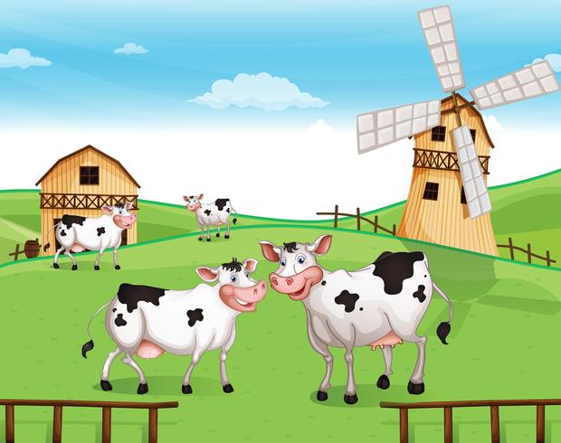 Cows at the hilltop with a windmill vector