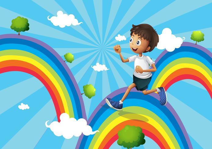 Een jongen die boven de regenboog loopt