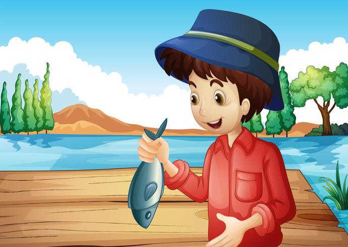 Un pescador sosteniendo un pez