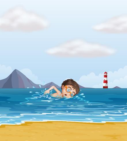 Un niño nadando en la playa con un faro.