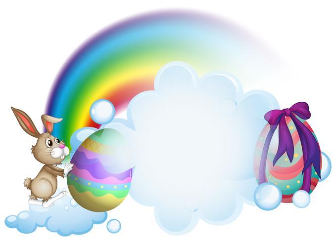 Un conejito y los huevos de pascua cerca del arco iris. vector