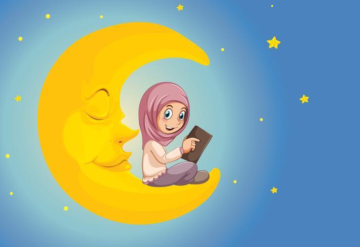 Une fille musulmane lisant sur la lune