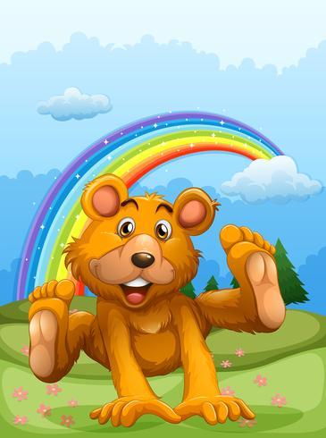 En glad björn leker med en regnbåge på baksidan