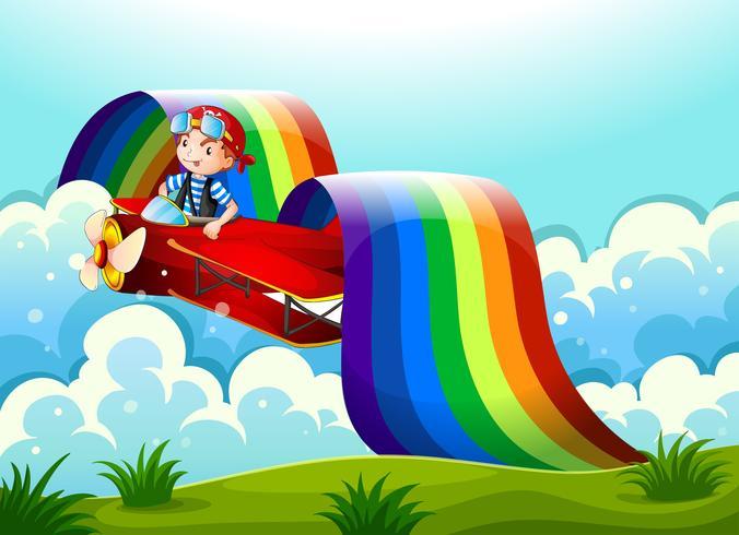 Een vliegtuig met een jonge jongen en een regenboog in de lucht