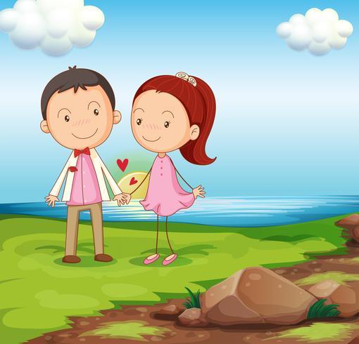 Um casal na margem do rio perto das rochas