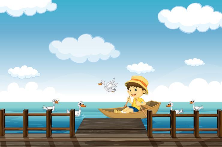 Un garçon qui fait du bateau