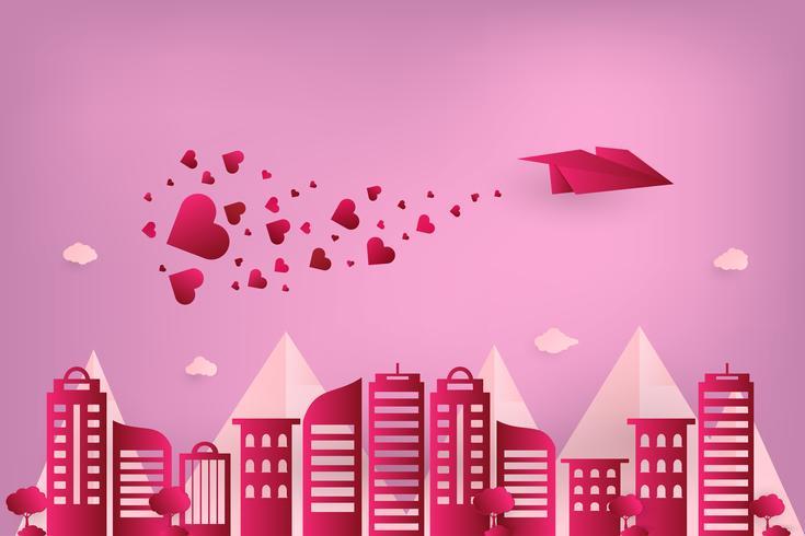 Concept kärlek och valentin dag. Origami pappersplan flyger över stadsstaden med hjärtspridning på himlen. papper konst stil.