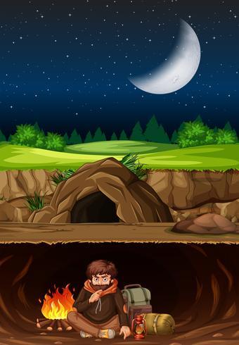 En man camping i grottan