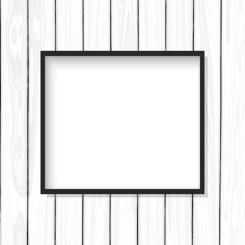 Cadre d'image vide sur une texture en bois blanche