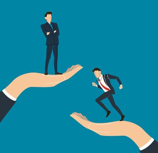 mão segurando o empresário bem sucedido em pé com os braços cruzados e executando o empresário