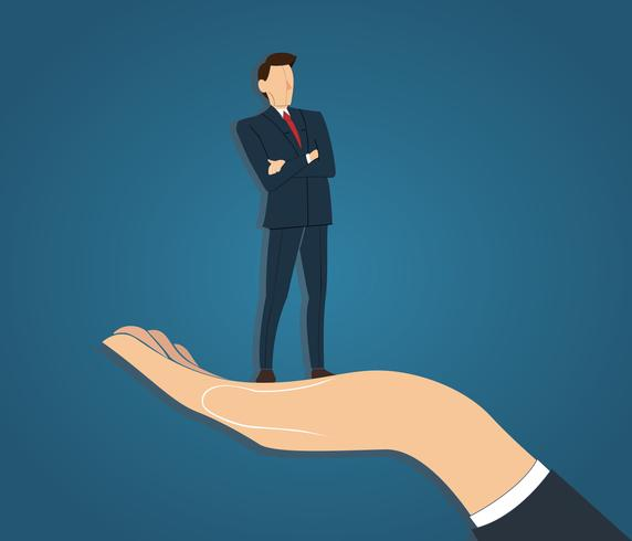 Successful businessman standing with crossed arms in big hand holding