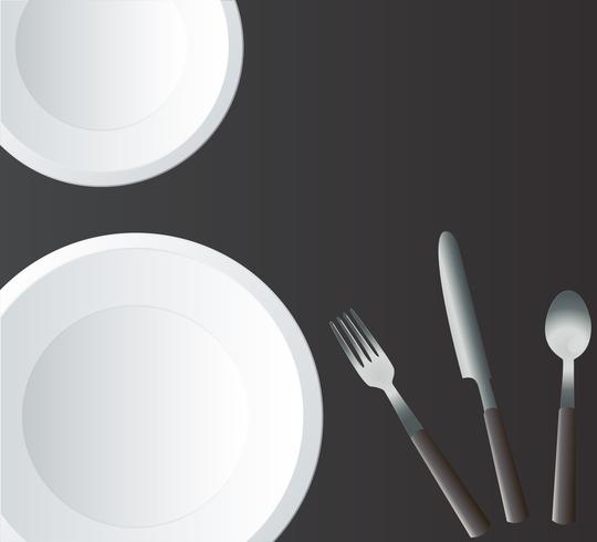 Piatto rotondo vuoto con forchetta e coltello
