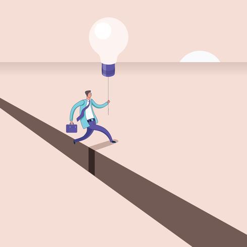 Geschäftsmann mit der Ballonidee, die über einen Abgrund springt