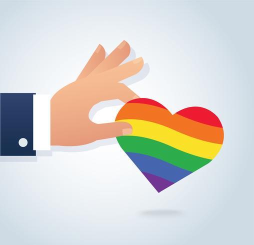 mano che tiene il vettore di cuore bandiera arcobaleno. L'amore è amore, l'amore vince