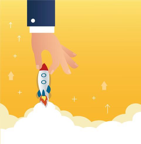 grote hand met een raket opstarten bedrijfsconcept