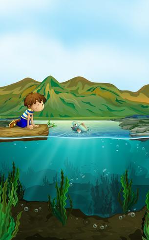 Escena de la naturaleza con niño y pez. vector