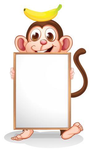 Un singe avec une banane au-dessus de sa tête tenant un tableau blanc vide