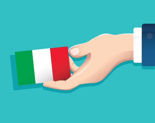 mão segurando o cartão de bandeira de Itália com fundo azul vetor