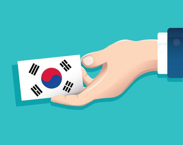 hand met Zuid-Korea vlag kaart met blauwe achtergrond